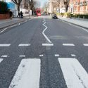 London, UK - March 13, 2016: Abbey Road zebra crossing made famous by the 1969 Beatles album,  in London, England, UK